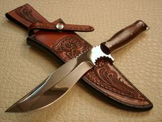 Recurve Fighter by Alex Collins. Mirror polished blade with notched choil, cocobolo handle, skull crusher pommel, fileworked. This rare fighter from the late Alex Collins represents some of the best of his work and is an excellent investment. 5.5 inch blade, 11.5 overall.