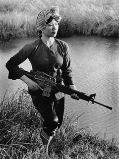 "Viet Cong guerrilla stands guard in the Mekong Delta, 1973. ""You could find women like her almost everywhere during the war,"" said the photographer. ""She was only 24-years-old but had been widowed twice. Both her husbands were soldiers. I saw her as the embodiment of the ideal guerrilla woman, who'd made great sacrifices for her country."" (Photographer: Le Minh Truong, ""Another Vietnam 1965-1975"", National Geographic Books)"