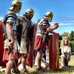 Native Briton girl brings Roman legionaries a drink of water at Fishbourne Roman Palace, August 2015