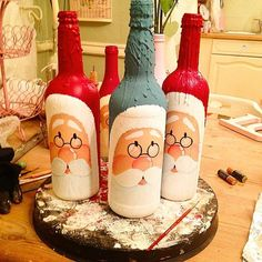 Second stage done on these handpainted win bottles. Painted Glass Bottles, Glass Bottle Crafts, Wine Bottle Art, Diy Bottle, Decorated Bottles, Christmas Wine Bottles, Bottle Painting, Decoration Table, Decorations