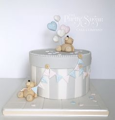 Grey and white stripe box gender reveal cake with teddy and balloon detail