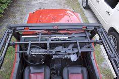 Jeep Gun Racks http://www.cabelas.com/product/Shooting/Gun-Storage/ATV-Gun-Bow-Racks|/pc/104792580/c/104730480/sc/104194980/Big-Sky-Racks-UTV-Bar/1276538.uts?destination=%2Fcatalog%2Fbrowse%2Fshooting-gun-storage-atv-gun-bow-racks%2F_%2FN-1100216%2FNs-CATEGORY_SEQ_104194980%3FWTz_l%3DSBC%253BMMcat104792580%253Bcat104730480&WTz_l=SBC%3BMMcat104792580%3Bcat104730480%3Bcat104194980