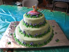 Tinkerbell cake for Sarah's 5th...my first tiered cake!  Royal icing flowers made ahead of time, cream cheese frosting, strawberry cake (see Favorite recipes board) and each layer filled with cream cheese icing mixed with simply fruit strawberry jelly.