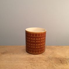 "Vintage Hornsea ""Saffron"" Cup  £5.00 Hornsea was wildly popular in the 70's and was produced until the early 90's.  This saffron cup is the perfect retro vibe for your home!  Dimensions  Height 9cm, Diameter 8cm."