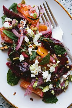 Sicilian–Inspired Blood Orange Salad by thekitchn: Oranges, red onion, mint, feta, dressed with oil/ red wine vinegar, cumin seeds and crushed pistachios