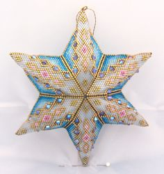 Star adapted from a peyote triangle pattern by Cris Rugar