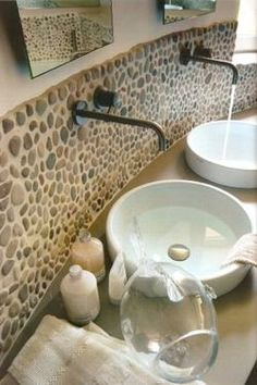 Java Tan pebble tile bathroom backsplash. Pebble tiles are extremely simple to install. There is no need to hire a professional tile installer which can save you a lot of money and for those DIY individuals out there, it's a pretty fun project to tackle. #Bathroom #Renovation and #Ideas