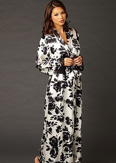 Wrap yourself in this petal-soft silk Indulgence print robe! Shimmering silk highlights the Calais lace along the cuffs of this long robe. White background with abstract black roses. 19mm silk means it's richer, fits more beautifully, and feels even more indulgent. XS to XXL.