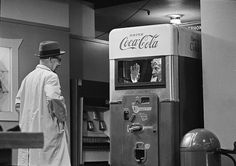 That's actually Harpo Marx surprising someone on Candid Camera from inside a Coca-Cola vending machine. | 15 Weird Vending Machines Of The '60s