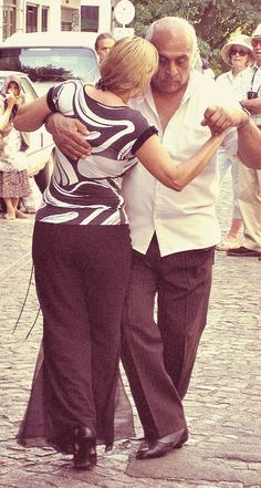 Italian Couple Dance the Tango in the Streets, Palermo, Sicily