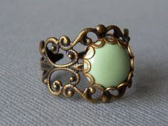 Mint Green Vintage Ring, Vintage Filigree with 10mm setting, Adorable Collection By Marina y Teresa. $8.00, via Etsy.