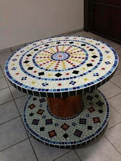 Upcycled mosaic spool table