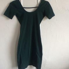 Forest green short sleeve u back dress Forest green short sleeve U back dress, cotton spandex material, body con dress, can wear to go out, casual, can layer over, can wear with a skirt, fits sizes xs/s, PERFECT CONDITION. American Apparel Dresses Mini