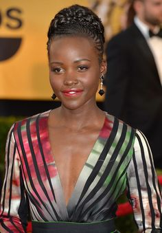 Lupita at the Sag Awards with stunning cornrow crown.