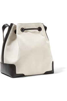 Ecru canvas, black leather (Calf) Drawstring top Weighs approximately 2.4lbs/ 1.1kg Made in Italy