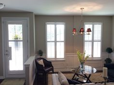 Window shutters and French door, custom cut-out shutter