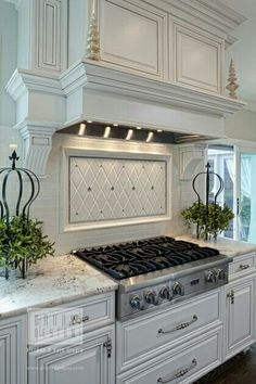 Subway tile is timeless. For a twist I'd do a quatrefoil mosaic above the stove instead.