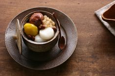 https://flic.kr/p/733TGX | A Japanese-Style Dessert with Two Chestnut Compotes | Brown compote = Shibukawani  Shibukawani is generally used for Western-style Japanese cakes.  Yellow compote = Kanroni  Kanroni is traditional chestnut compote which is indispensable for Japanese New Year dishes.  and shiratama-dango, sweetened white azuki beans, red peas