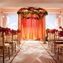 Paula & Enrique's ceremony decor of orange parrot tulips, amaryllis, kumquats and lemon leaves from Grymes Cannon Designs and Jenevieve Peralta.