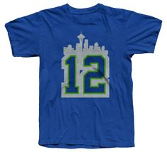 Seattle Seahawks 12th Man Seattle, Washington skyline (featuring the Space Needle) t-shirt. Women's sizes also available. Made in the USA.