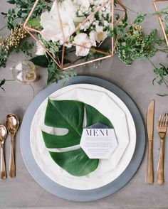 33 Tropical Wedding Ideas We Love | Martha Stewart Weddings - Add just a hint of tropical appeal to your place settings with an oversized palm leaf. Paired with geometric details, like the copper centerpiece and Paper Dolls Design menu card, keep the look feeling refined and not overly beachy.