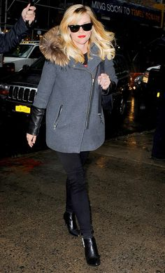 Reese Witherspoon kept it classic in a grey fur-hood coat, black jeans and a red lip