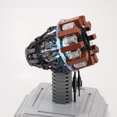 Tony Stark's Arc Reactor is essential to his existence. Steampunk Lego, Steampunk Design, Iron Man Arc Reactor, Lego Iron Man, Iron Man Armor, Lego Blocks, Lego Mecha, Cool Lego Creations, Lego Worlds