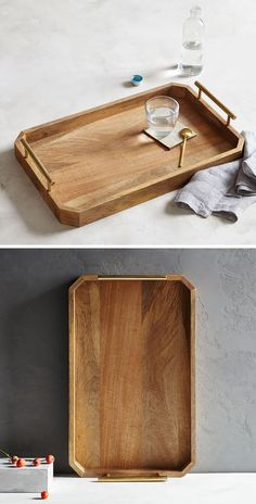 11 Decorative Wood Trays To Add A Natural Touch To Your Interior The sides of this wood tray eliminate the worry of things being knocked off, and the bar handles on both sides of the tray make it easy to transport and move when necessary.
