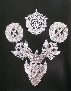 details of russian court orders - part of the imperial jewels sold by the soviets. Empress Alexandra is seen wearing these jewels in her formal portrait taken in 1906 for the Duma.