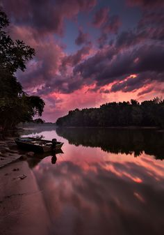 A passing storm lights up at sunset over the Wabash River at Fort Ouiatenon in West Lafayette