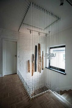 Whoa! Tension wires used to create a transparent wall and stair rail. Brilliant!