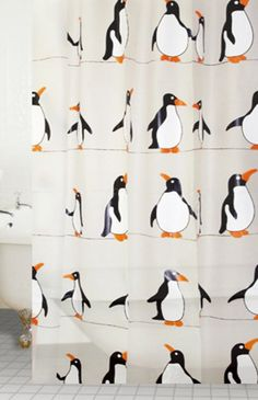 """Blue Canyon """"Penguin"""" shower curtain. If you can't face magenta, hot orange or lime green in your bathroom, why not add a subtle but fun touch of """"funky"""" with this penguin parade shower curtain?"""