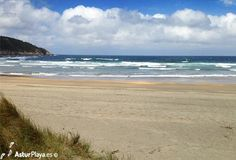 The Otur beach in Asturias, Spain - sand, sea and dunes with grass