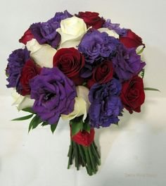 Purple white and red bouquet with roses