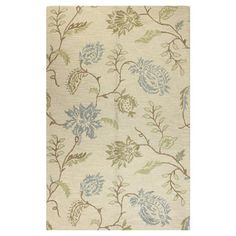 Hand-tufted wool rug with floral motif.  Product: RugConstruction Material: 100% WoolColor: Ivory
