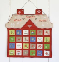 Cross stitch house - I have an idea to see these symbols I windows of a house box frame....