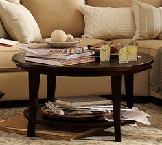 Had my eye on this one for about a year.  I like the simplicity of it. Metropolitan Round Coffee Table, Espresso stain #potterybarn