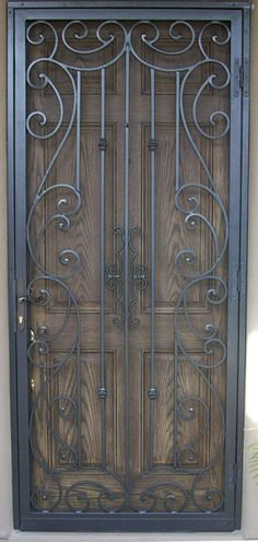 Beautiful wrought iron security door working beautifully with the design in the wood