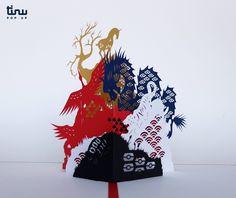 Carte pop up représentant les wuxing sous leur forme animale : tortue, tigre, oiseau, dragon, licorne.