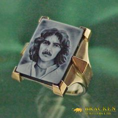 Bracken crafted this custom cameo ring as a remembrance piece for a rock legend. It features a beautifully hand carved banded agate cameo portrait set in a 14k white and 18k pink gold setting. The sides of the ring feature the towers of Harrison's Thames River castle, where he lived for many years. The underside reveals two of Harrison's favorite symbols with the black onyx showing through the inlaid gold motifs.