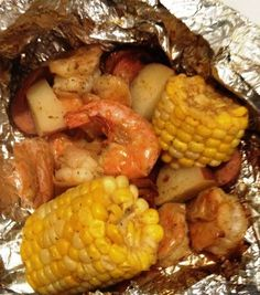 Cajun Shrimp & Sausage Packets 1 & 1/2 lb large shrimp, peeled (and de-veined if you like) 1 package smoked Andouille sausage, thinly sliced 2-3 ears corn, cut into 4 pieces 1 lb baby red potatoes, halved 2 tbsp olive oil 4 tsp Cajun seasoning (use old bay if you prefer) 2 cloves garlic, minced juice from 1 lemon sale and pepper to taste 2 tbsp fresh parsley, chopped aluminum foil