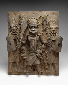 Benin Warriors Plaque (by Metropolitan Museum of Art, New York) - A cast brass plaque depicting warriors of the kingdom of Benin (13-19th century CE) in West Africa (modern southern Nigeria). The central figure is likely a king (Oba). From Benin City , 16th-17th century CE. Height: 47.6 cms (Metropolitan Museum of Art, New York) Modern History, Art History, History Essay, Ancient History, Brass Plaques, Royal Art, African Masks, Gustav Klimt, African History