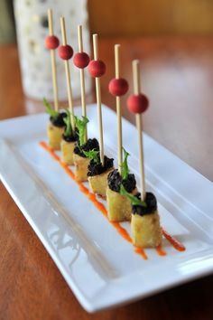 Fried Green Tomato Appetizers by Master Chef of the Year, José Gutierrez of River Oaks in Memphis, serves up this Southern classic with sophistication – bite size tradition on a skewer.