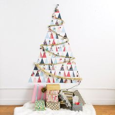 DIY a Non-Traditional Christmas Tree Out of Holiday Cards in Under 60 Minutes via Brit + Co