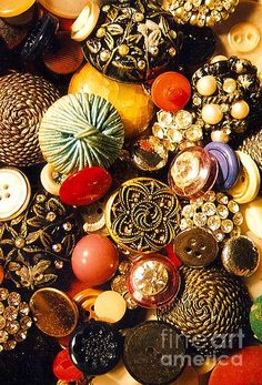 Beautiful vintage buttons.  I still have a big jar of them from coats, robes, blouses, and cardigans over the years.