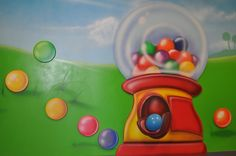 Creative kids theming that inspires!  A little 3-D element coming out of the gumball machine.