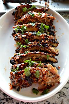 We share the ultimate secret to GARLIC OYSTER SAUCE - Oyster Sauce Garlic Asian Barbecued Ribs. Grilled to perfection with an amazing spice your taste buds will devour. Pork Rib Recipes, Pork Tenderloin Recipes, Veggie Recipes, Asian Recipes, Smoker Recipes, Lamb Recipes, Veggie Food, Thai Recipes, Free Recipes