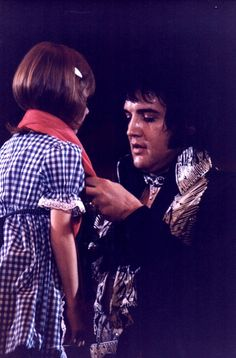 Elvis Giving A Scarf On Stage 1975 | Flickr - Photo Sharing!