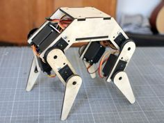 Designing a quadruped robot? Take a look at this use of servos http://letsmakerobots.com/robot/project/felix-v2?page=1