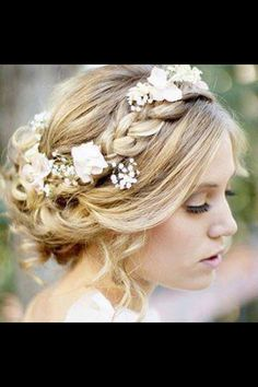How I want my hair for my wedding. No veil. Just subtle flowers intertwined soft braids and curls. Beautiful.